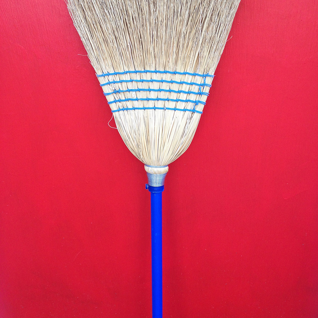 Broom on Red Door